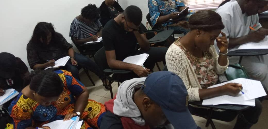 People writing exams at IELTS test centers in Nigeria